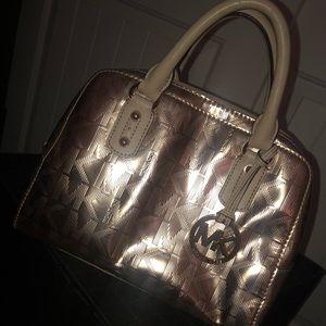 Metallic rose gold MK bag